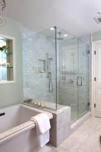 glass doors small bathroom:  glass door shower and nickel handset with symmetrical light bulbs adds