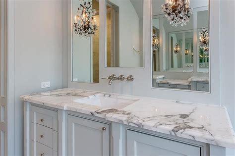 white bathroom  greek key mirror  antiqued mirrored