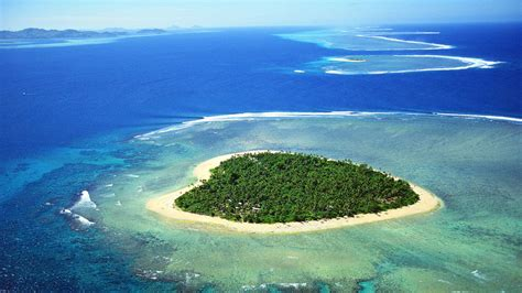 my tiny heart shaped island and yes there s a hotel on it