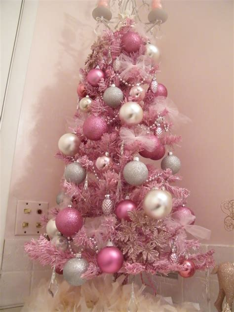 white christmas tree with pink decorations bedroom