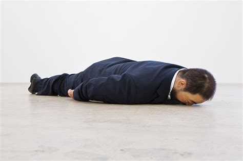 sculpted ai weiwei by he xiangyu lies on the ground