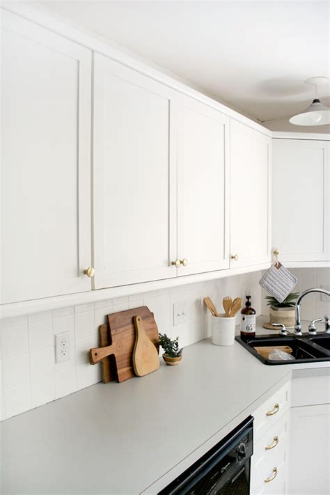 adding molding to laminate cabinets how to add trim and paint your laminate cabinets brepurposed