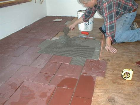 How To Lay Tile On Concrete Floor by Flooring How To Install Ceramic Floor Tile Cleaning