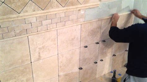 how to put tile on wall in bathroom how to install travertine tile on bathroom walls youtube