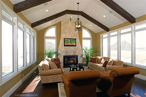 sunroom with fireplace and wood beams home