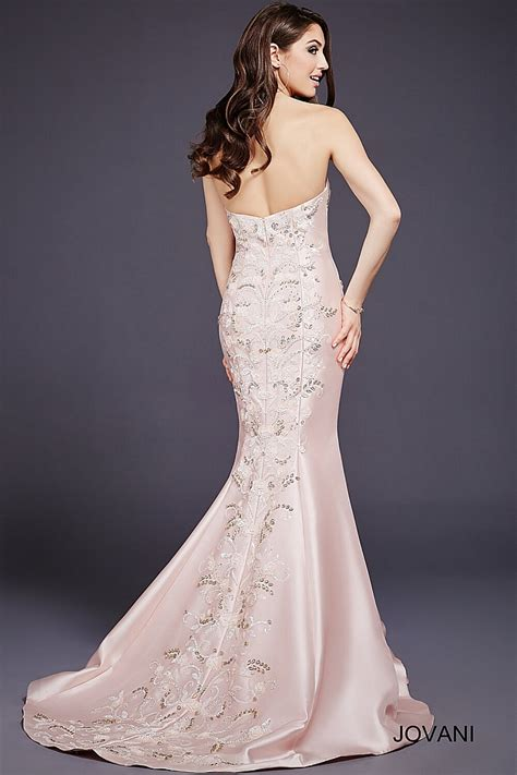 blush mermaid gown with a plunging neckline and beaded