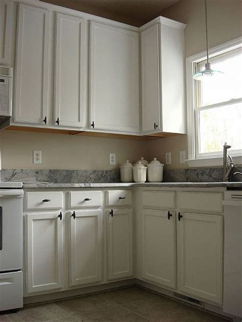 oak cabinets painted white and distressed