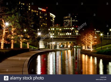 christmas lights at night along the woodlands waterway in