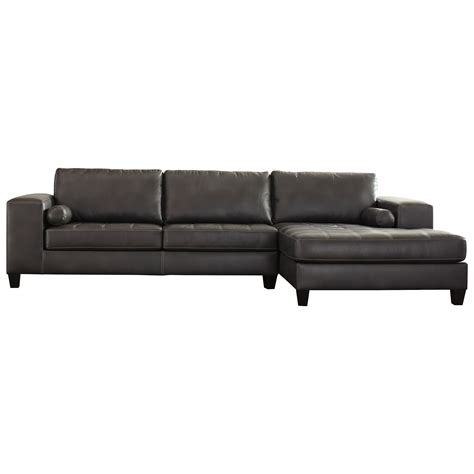 Ashley Signature Design Nokomis Contemporary Faux Leather Faux Leather Sectional Sofa With Chaise