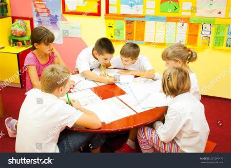elementary school children sitting around stock