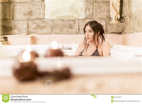 pretty woman bathtub pretty young woman relaxing in the hot tub stock images