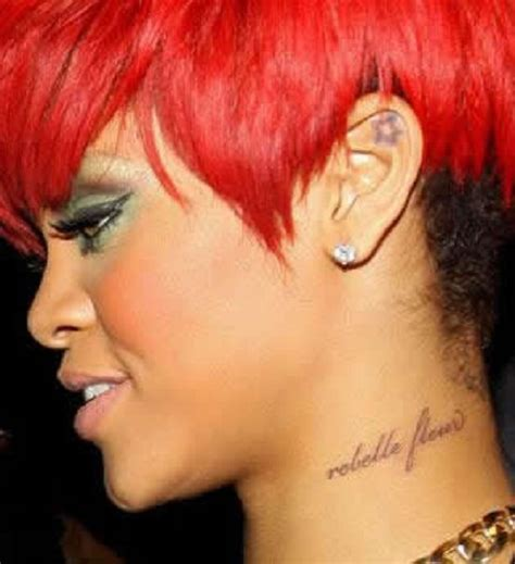 rihannas tattoos chini live keeping up with the buzz rihanna s