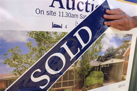 auction sign on house replaced with sold sign abc news