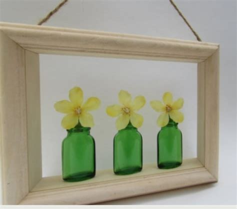 Shadow Box Wall Decor by Shadow Box Green Glass Bottles And Yellow Silk Flower