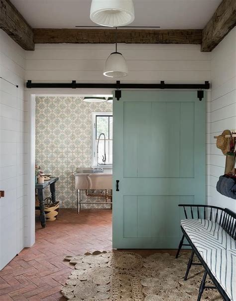rustic cottage mudroom boasts white shiplap walls framed