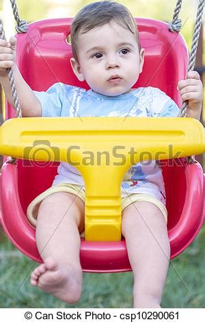baby swing for 6 month old stock image of baby boy in swing close up of 9 month old