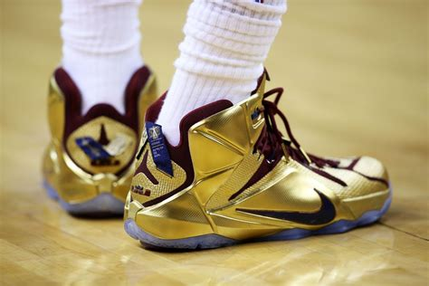 lebron playoff shoes lbj wears shiny nike lebron 12 quot cavs gold quot finals pe in