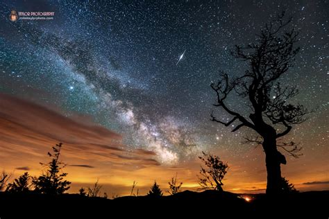 Bright Light In Western Sky by Nature In One Astrophoto Iridium Flare Way Clouds And Light Pollution