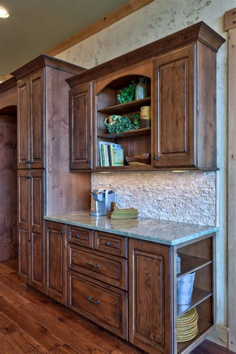 how to lighten dark stained cabinets rustic lodge inspired kitchen stone backsplash cabinets