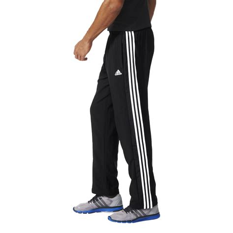 home adidas adidas mens essentials 3 stripes woven workout adidas mens essentials 3 stripes woven pant in long