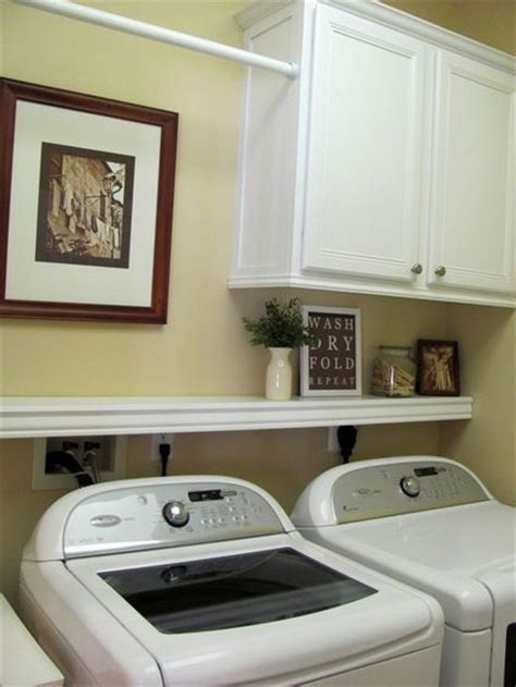 laundry room shelf with hanging rod laundry room ideas cabinet shelf and hanging rod i like this b c it still allows the dryer