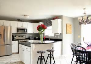 Pictures Of Kitchens With White Cabinets And Black Appliances Black And White Kitchen Remodel With Painted Cabinets