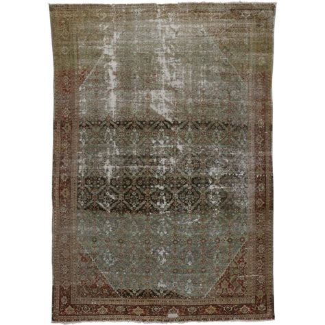 industrial rugs distressed antique mahal rug with modern industrial style for sale at 1stdibs