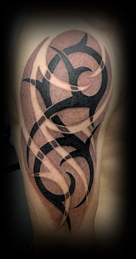 tribal sleeve tattoo for men half sleeve black ink tribal for