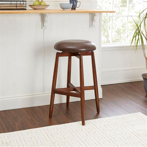 Brown Saddle Bar Stools by Silverwood Dover 29 In Brown Upholstered Saddle Bar Stool