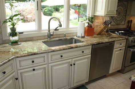 White Kitchen With Yellow Accents - yellow river granite counter tops traditional kitchen