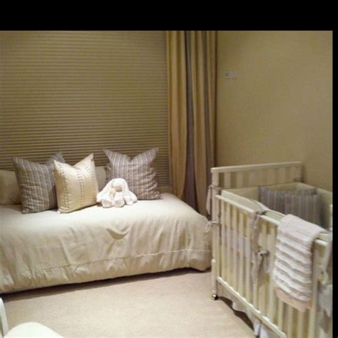 bed with a lot of pillows love this basic bed frame in the nursery lots of pillows