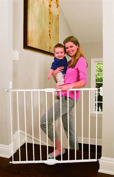 swinging baby gates com munchkin extending metal gate white