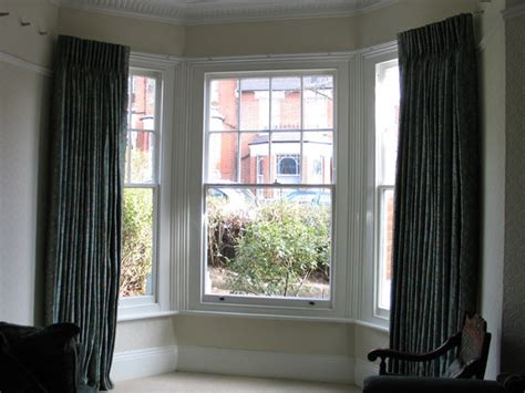 curtains for double window bay window double curtain rods a creative mom