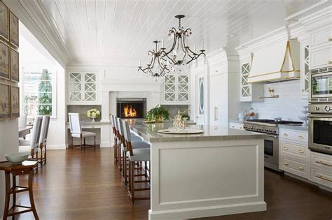 Large Kitchen Islands With Seating gourmet kitchen with raised white brick fireplace