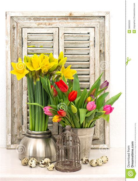 home decoration with flowers easter eggs stock