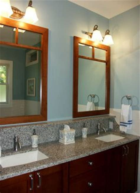 bathroom with cherry cabinets with granite counter top vanity and blue walls bathrooms