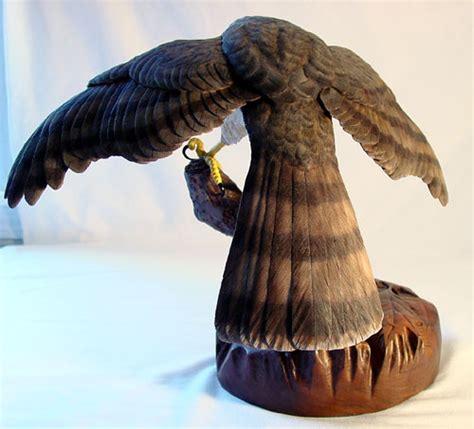 Mantling Cooper?s Hawk   Birds in Wood