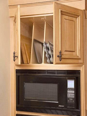 cookie sheet cabinet divider ultimate storage packed kitchens