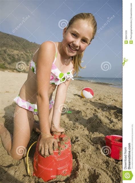 preteen little play young girl playing in sand at beach stock image image of
