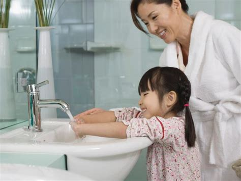 mom and son in bathroom bath remodeling what to consider hgtv
