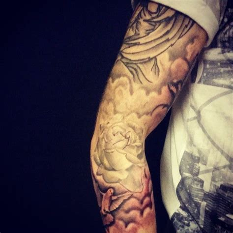cloud and rose tattoos work done to ma sleeve ink dove clouds