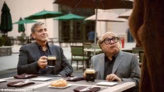 nespresso commercial actress jack black george clooney takes danny devito under his wing for