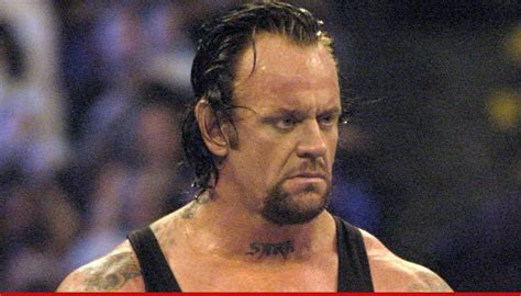 undertaker tattoo the worst tattoos in sports scoreboredsports