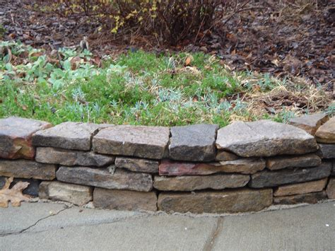 flower bed edging stone stacked stone flower bed border front yard curb appeal pinterest stone flower