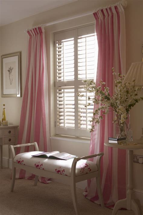 plantation shutters and drapes enhance the appeal of your home with plantation shutters