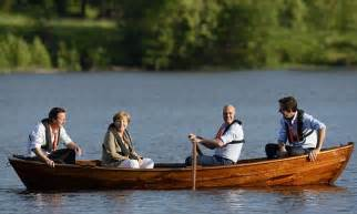 sinking rubber boat david cameron goes rowing in sweden with angela merkel and
