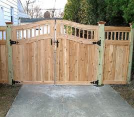 privacy fence with arched spindles by elyria