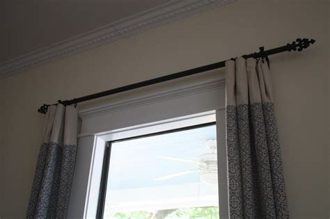classic family room with oil rubbed bronze curtain rods