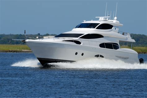 i want a free boat white yacht on running on blue body of water during