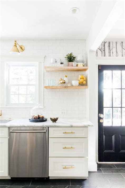 white shaker cabinets gold pulls design ideas white and gold kitchen with stacked wooden floating